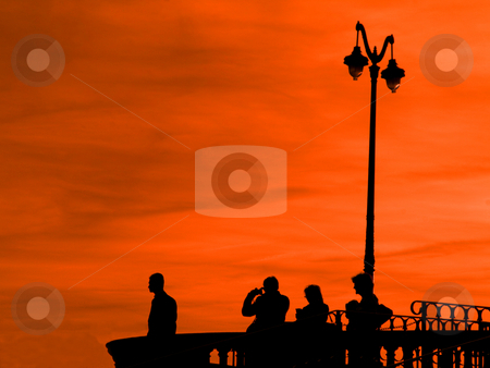 Observation desk at twilight stock photo, Group of people at an observation desk at twilight with red sky by Laurent Dambies