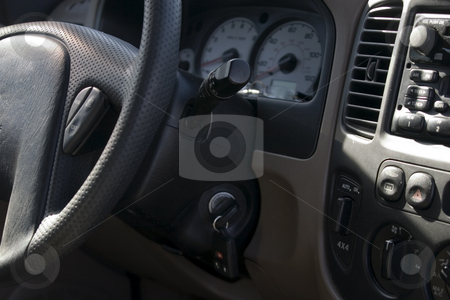 Steering wheel and the front  panel stock photo, Close up on the steering wheel and the front  panel by Mehmet Dilsiz