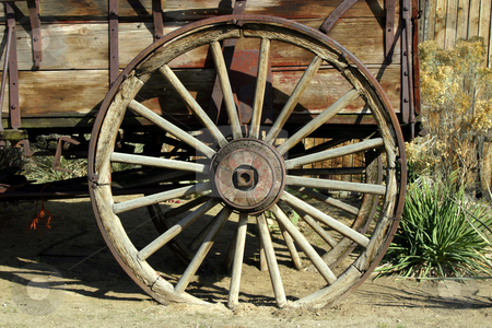 Old Antique Wagon Wheel stock photo, Close up on an Old Antique Wagon Wheel by Mehmet Dilsiz