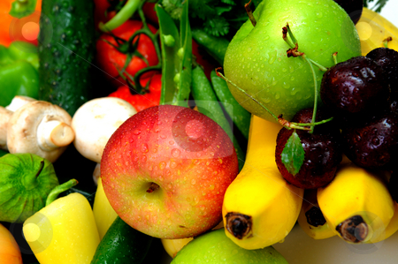 Fruit And Vegetables stock photo, Assorted fresh fruit and vegetables with a fuji and green apple in the foreground. by Lynn Bendickson