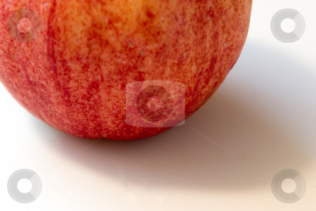 Close up on an Old Apple stock photo, Extreme Close up on an Old Apple that looks like a Peach by Mehmet Dilsiz