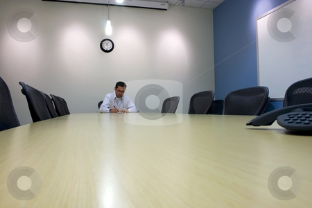Signing a Document in a Conference Room  stock photo, Businessman signing a Document in a Conference Room by Mehmet Dilsiz