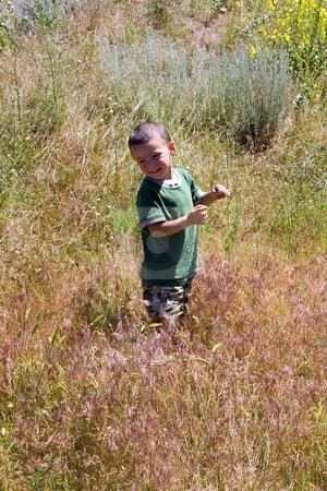 Little Boy in the Prairie stock photo, Little Boy Looking back in the Prairie by Mehmet Dilsiz