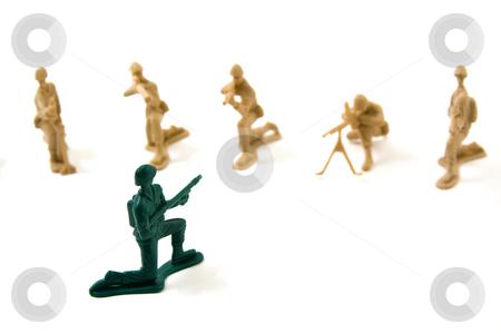Stubborn Concept - Plastic Army Men stock photo, Isolated Plastic Toy Soldiers - Stubborn Concept by Mehmet Dilsiz