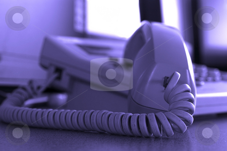 Close up Business Phone stock photo, Close up on a Business Phone with Focus on the Cord by Mehmet Dilsiz