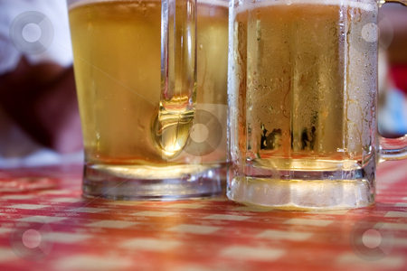 Two Glasses of Beer stock photo, Close up on Two Glasses of Beer Sweating by Mehmet Dilsiz