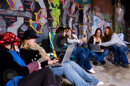 Teeangers on their laptops stock photo, Teenagers working on their laptops with grunge background by Mehmet Dilsiz