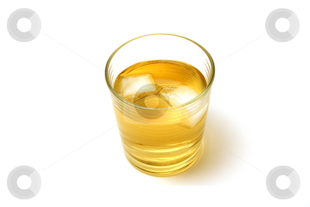 Whiskey stock photo, Close up shot on a Glass of Whiskey by Mehmet Dilsiz