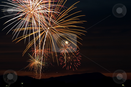 Firecrackers In The Sky - Sunset stock photo, Firecrackers During Fourth of July - New Years Eve by Mehmet Dilsiz