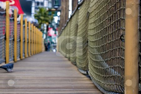 Sidewalk in the strip in Las Vegas - Pirate / dock themed sidewa stock photo, Sidewalk in the strip in Las Vegas - Pirate / dock themed sidewalk DOF, close up on the ropes with pigeon and people on the background by Mehmet Dilsiz