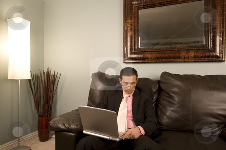 Home or Office - Businessman Working on the Couch stock photo, Home or Office - Businessman Looking over His Glasses on the Couth by Mehmet Dilsiz