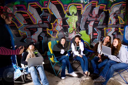 Teeangers Hanging Out stock photo, One Teenager talking to the others by Mehmet Dilsiz