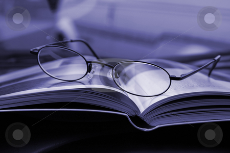 Close up on the Glasses and the Magazine stock photo, Glasses and the Magazine - Close Up by Mehmet Dilsiz