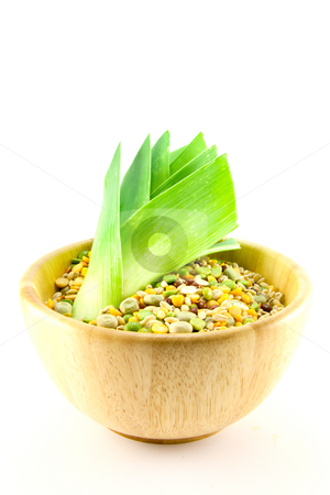 Soup Pulses and Leek stock photo, Wooden bowl of soup pulses with leek on a white background by Keith Wilson