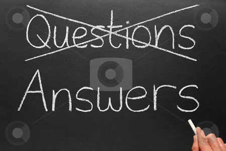 Crossing out questions and writing answers on a blackboard. stock photo, Crossing out questions and writing answers on a blackboard. by Stephen Rees