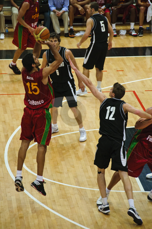 FIBA Trentino Cup: Portugal vs New Zealand stock photo, Game 1 of FIBA Trentino Cup: Portugal vs New Zealand. The tournament was played in Trento (Italy) between the 25th and the 27th of July 2009. Portugal player Santos shoots from the arch for a 3 points basket. Photo taken on the 25th of July, 2009. by Alessandro Rizzolli