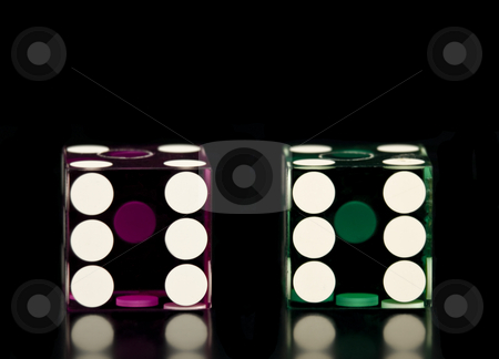 Two Dice stock photo, Two Dice on a black background with reflection by John Teeter