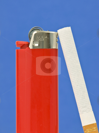 Cigarette and Lighter stock photo, Cigarette and lighter on a blue background by John Teeter