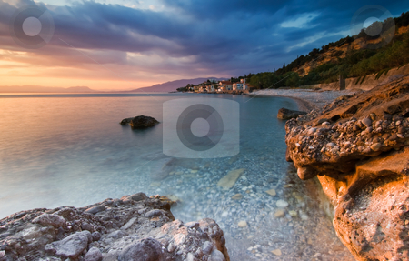 The beach at Akrogiali stock photo, This picture shows the beach and village of Akrogiali, near the city of Kalamata, southern Greece by Andreas Karelias