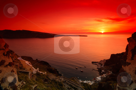 Sunset in Santorini stock photo, Image shows a spectacular sunset in the village of Oia, Santorini, Greece by Andreas Karelias