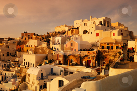 Waiting for the sunset stock photo, Image shows the traditional village of Oia, on the Greek island of Santorini with hundreds of tourists waiting for one of its famous sunsets by Andreas Karelias