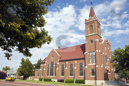 Church stock photo, Handsome brick church grace a corner in a small town by Bart Everett