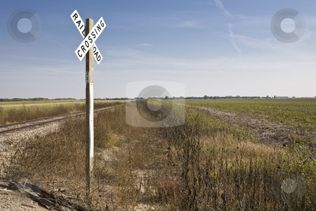 Rural Railroad Crossing stock photo, Railroad Crossing sign in rural Kansas by Bart Everett