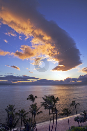 Sunset over Kaanapali Beach in Maui stock photo, Sunset casts a golden glow over the ocean at Kaanapali Beach on Maui. by Bart Everett