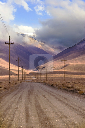 Silver Canyon Road stock photo, Power poles line the dirt road leading to Silver Canyon in California's White Mountains shrouded in mist and clouds on a winter day. by Bart Everett