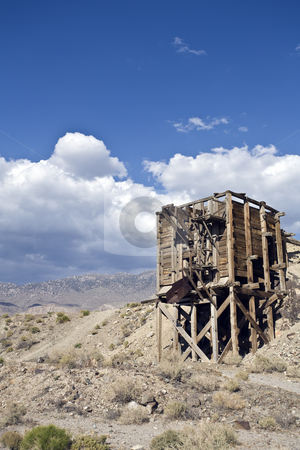 Desert Mine Chute stock photo, A remnant of the mining days in California's Owens Valley sits abandoned on a desert hillside. by Bart Everett
