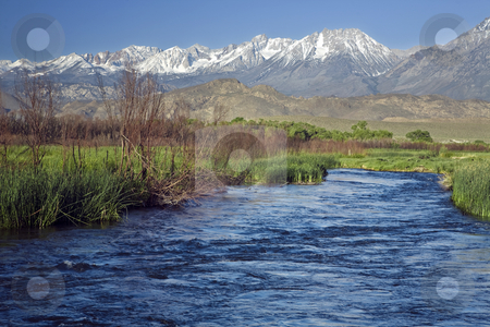 Owens River Sierra stock photo, The Owens River flows against a background of snow-capped mountains. by Bart Everett