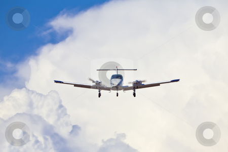 Airplane Landing Approach stock photo, Airplane in landing configuration against a backdrop of cumulous clouds by Bart Everett