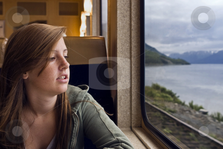 Train Trip stock photo, A young girl gazes out the window of a dining car on the Alaska Railroad by Bart Everett