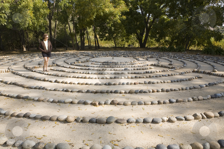 Labyrinth stock photo, In deep thought, a lone woman walks a forest labyrinth by Bart Everett