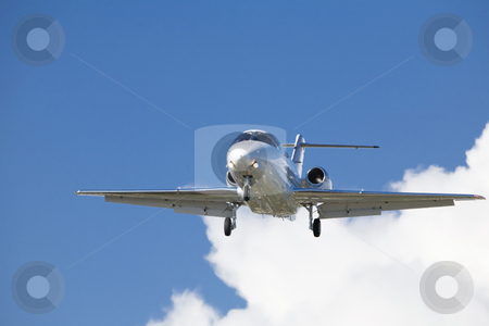 Airplane Jet Landing Approach stock photo, Airplane in landing configuration against a backdrop of cumulous clouds by Bart Everett