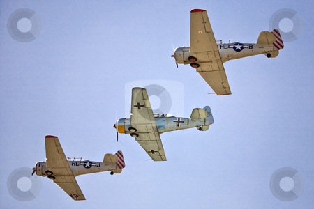 Vintage Aircraft in Formation stock photo, Three World War II training airplanes, with American and German insignia, fly in formation by Bart Everett
