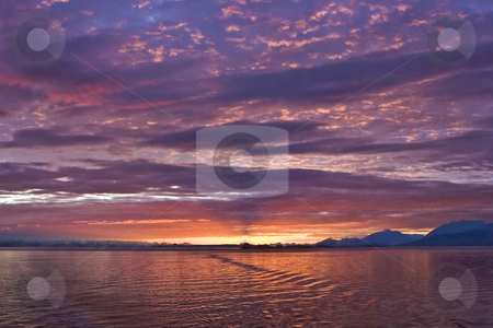 Alaskan Sunset Over Prince William Sound stock photo, Sun sets over the waters of Prince William Sound in Alaska, lighting up a beautiful array of high clouds. by Bart Everett