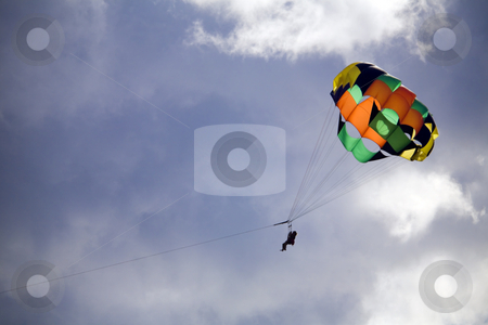 Parasailing over Kaanapali Beach, Maui, Hawaii stock photo, Adventurous couple soars among the clouds on beach parasailing ride by Bart Everett