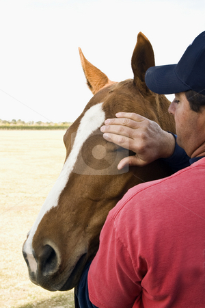 Quiet moment with a polo horse stock photo, Chris Kerley with one of his polo horses by Bart Everett