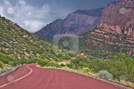 Storm Over Zion stock photo, Rainy weather moves over a highway winding through bluffs in Zion National Park. by Bart Everett