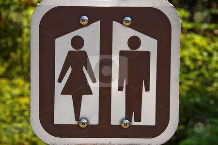 Restroom Sign stock photo, This sign is for men and women's restrooms and colored brown and cream with nature in the background. by Valerie Garner