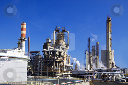 Oil refinery in Italy stock photo, Oil refinery in Italy Milazzo Sicily with tall smokestacks by Daniel Kafer