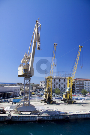 Industrial cranes stock photo, Three industrial cranes at the harbor in Messina Sicily by Daniel Kafer