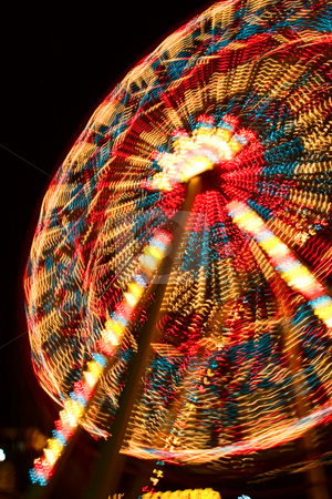 Joy Wheel stock photo, A night shot of illuminated joy wheel taken with long exposure by Andrey Lukashenkov