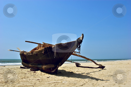 Fishing boat on the beach stock photo, Fishing boat on sandy beach in Goa, India by Andrey Lukashenkov