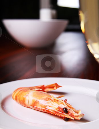 Shrimp and champagne stock photo, Giant shrimp on a plate and a glass of champagne by Daniel Kafer