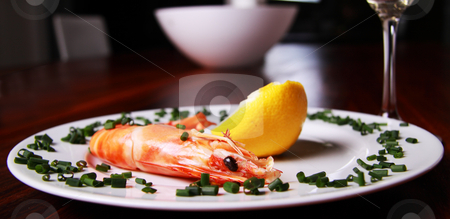 Shrimp and champagne stock photo, Giant shrimp on a plate, a glass of champagne and a lemmon by Daniel Kafer
