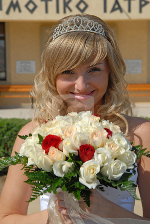 Happy smiling Bride stock photo, Beautiful blond Bride with the wedding flowers.  Was shot 24.10.2007 at Cyprus. by Sergey Kuznetsov