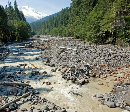 Low Creek Bed with Snow Capped Mountain stock photo, This creek bed is low with