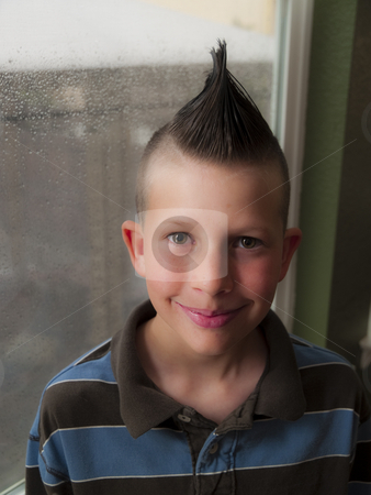 Punk child stock photo, A little boy with a mohawk hair do by Cora Reed